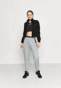 Calvin Klein Performance - PANTS - Teplákové kalhoty - green - 1