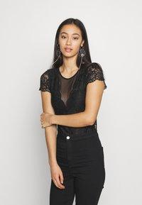Morgan - DONAO - Camiseta estampada - noir - 0