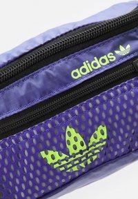 adidas Originals - WAISTBAG UNISEX - Bum bag - purple/black/signal green - 4