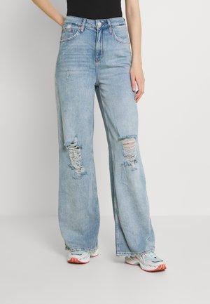 PUDDLE - Flared jeans - summer vintage