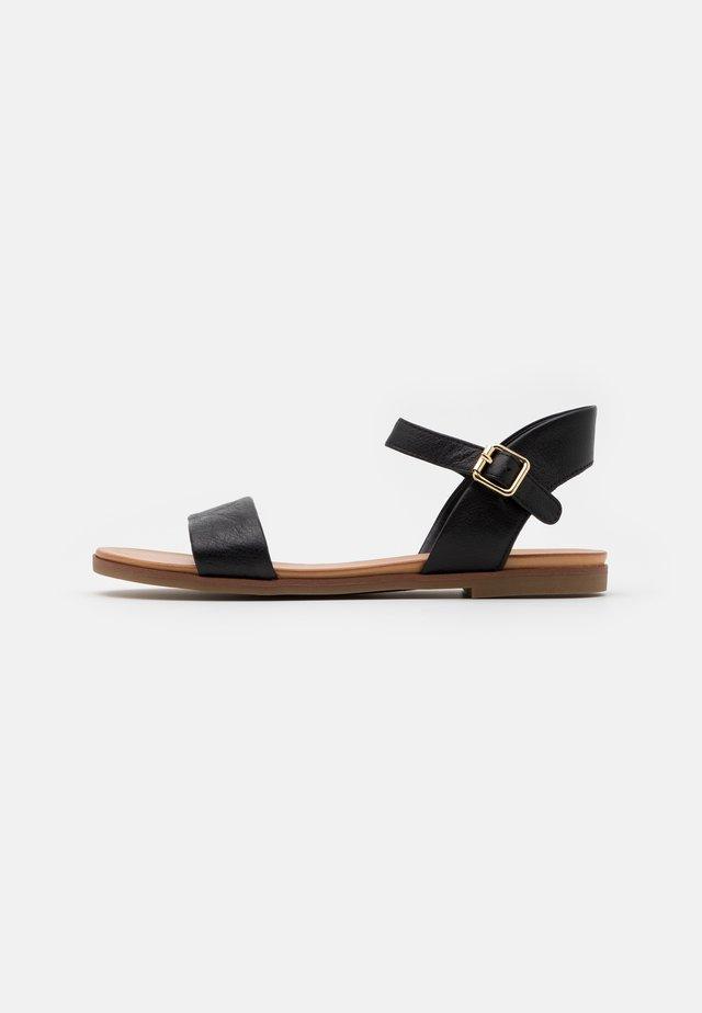 ETERILLAN - Sandaalit nilkkaremmillä - black
