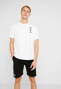 Kappa - GEWORG - T-shirt con stampa - bright white - 0