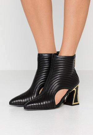SITA - Ankle boots - black/gold
