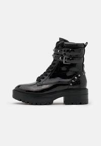 Guess - FLORICE - Cowboy/biker ankle boot - black - 1