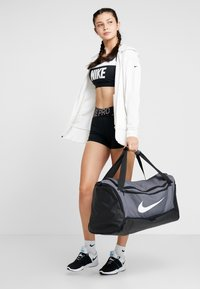 Nike Performance - DUFF - Sports bag - flint grey/black/white - 1