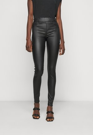 EDEN - Trousers - black