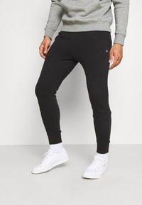 Calvin Klein Golf - PLANET - Pantalon de survêtement - black - 0
