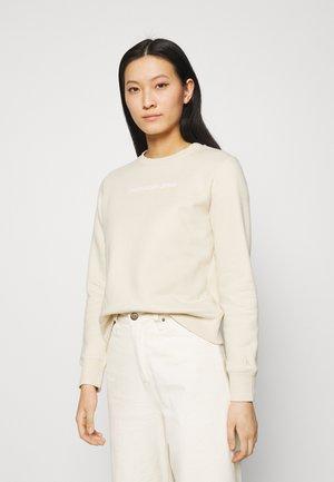 SHRUNKEN INSTITUTIONAL CREW NECK - Sweatshirt - beige