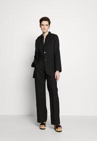 Lovechild - LEA - Trousers - black - 1