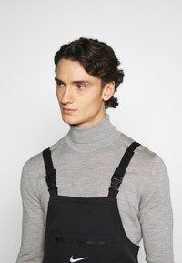 Nike Sportswear - OVERALLS - Stoffhose - black/white - 3
