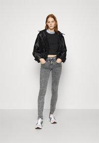 Calvin Klein Jeans - LOGO ELASTIC MILANO - Long sleeved top - black - 1