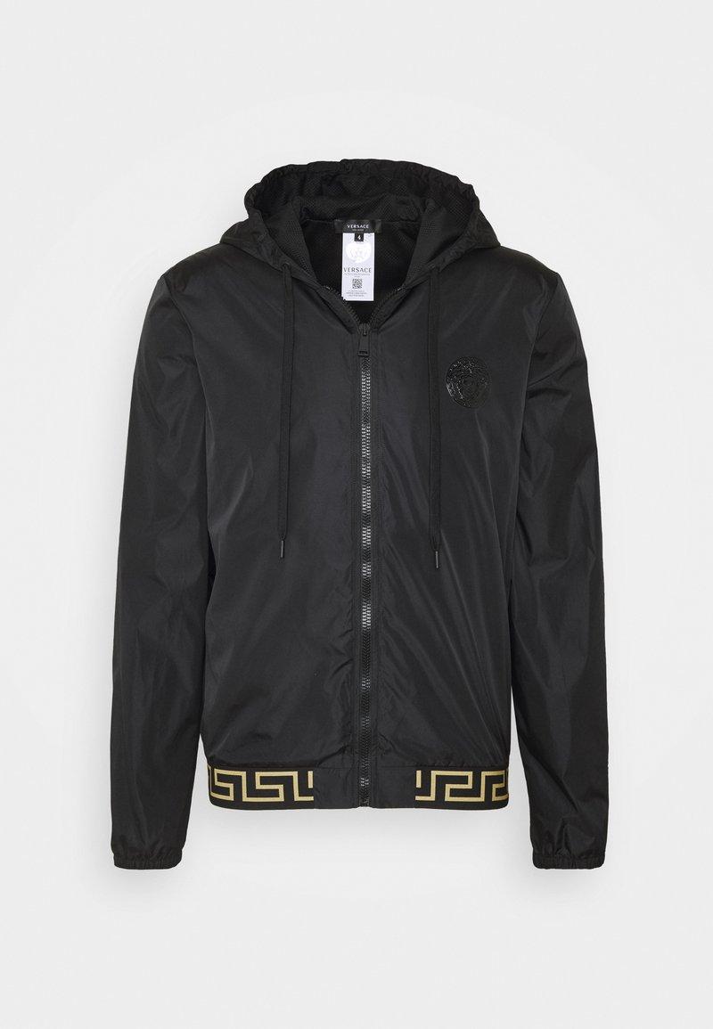 Versace - GIUBBINO GYM UOMO - Lehká bunda - nero