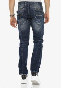 Cipo & Baxx - MIT ZIERNÄHTEN UND REISSVERSCHLÜSSEN - Straight leg jeans - donkerblauw - 2