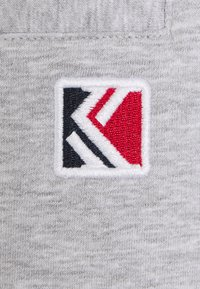 Karl Kani - SIGNATURE  - Tracksuit bottoms - ash grey - 6