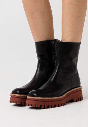CLERMONT - Platform ankle boots - black