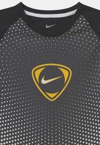 Nike Performance - ACADEMY UNISEX - Print T-shirt - black/white - 2