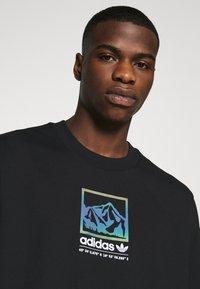 adidas Originals - SPORTS INSPIRED LOOSE SHORT SLEEVE TEE - Triko spotiskem - black - 3