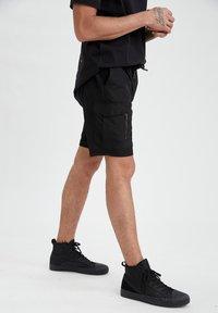 DeFacto - Pantaloncini sportivi - black - 0