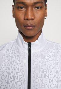 Calvin Klein - TRANSPARENT RIPSTOP LOGO BLOUSON - Summer jacket - white - 4