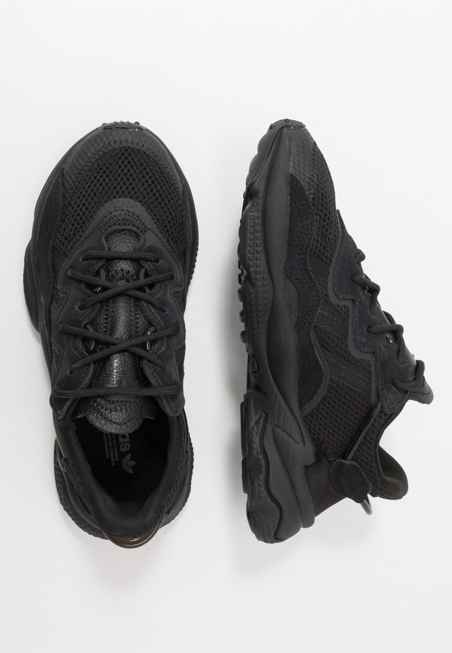OZWEEGO - Sneakers laag - core black/trace grey metallic
