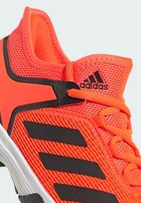 adidas Performance - UBERSONIC 4 K - Multicourt tennis shoes - orange - 5