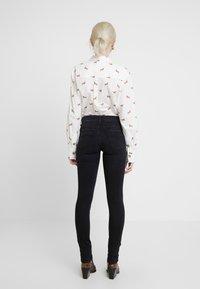 Replay - LUZ HIGH WAIST HYPERFLEX CLOUDS - Jeans Skinny Fit - black - 2