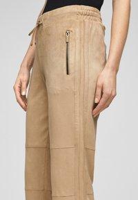 s.Oliver BLACK LABEL - Tracksuit bottoms - brown - 5