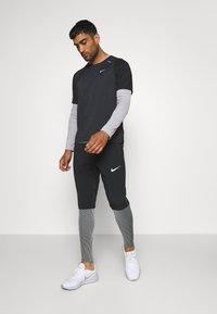 Nike Performance - Triko spotiskem - black - 1