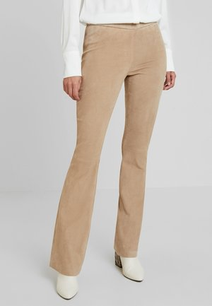 Leather trousers - beige