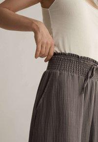 OYSHO - Tracksuit bottoms - beige - 3