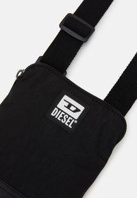 Diesel - BULERO - Across body bag - black - 3