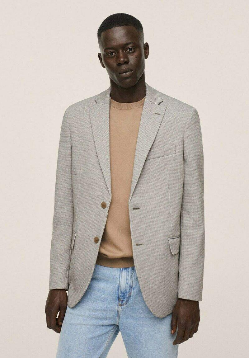 Mango - Blazer jacket - open beige