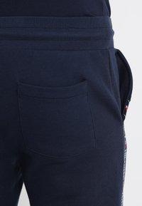 Tommy Hilfiger - TRACK PANT - Pyjama bottoms - blue - 3