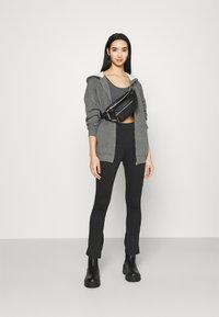 NA-KD - NA-KD X ZALANDO EXCLUSIVE  SIDE SLIT - Leggings - Trousers - grey - 1