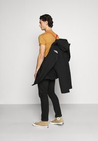 The North Face - NEW OUTERBOROUGHS JACKET - Down coat - black - 4