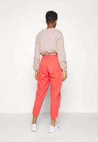 adidas Originals - Tracksuit bottoms - coral - 2