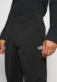 The North Face - MENS SURGENT CUFFED PANT - Træningsbukser - black - 6