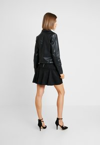 Pieces - PCRIONE BIKER ZIP JACKET - Faux leather jacket - black - 2