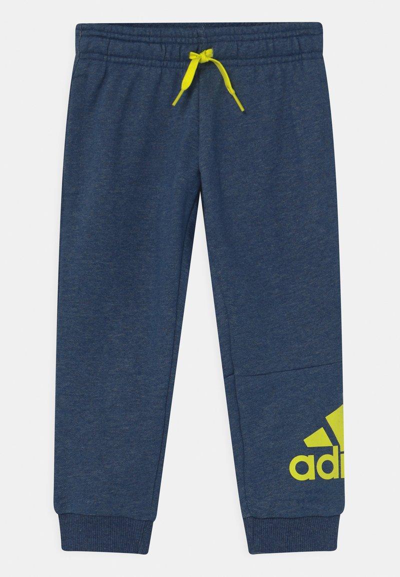 adidas Performance - UNISEX - Tracksuit bottoms - dark blue/neon yellow