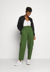 Pepe Jeans - DUA LIPA x PEPE JEANS - Trousers - khaki green - 1