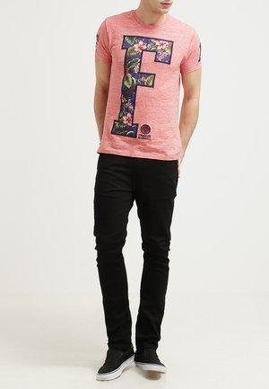 STEFAN - Slim fit jeans - black
