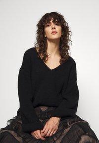 TWINSET - GONNA LUNGA BALZE - A-line skirt - nero - 4