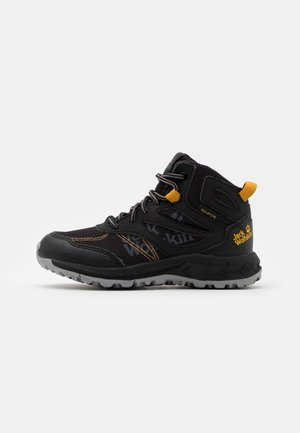 WOODLAND TEXAPORE MID UNISEX - Hiking shoes - black/burly yellow