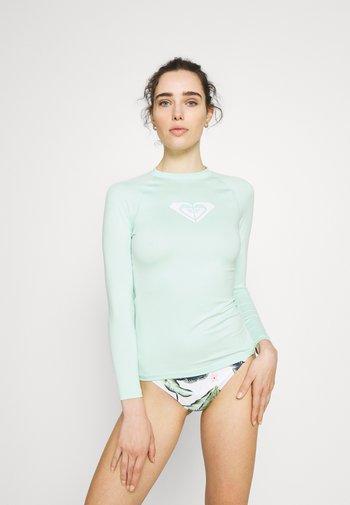 WHOLEHEARTED - Camiseta de lycra/neopreno - brook green