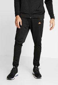 Ellesse - CALDWELO PANT - Teplákové kalhoty - black - 0