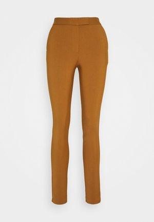 TAIKA - Trousers - dark honey