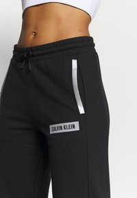 Calvin Klein Performance - PANTS - Tracksuit bottoms - black - 3
