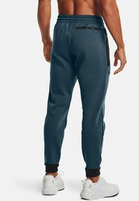 Under Armour - Tracksuit bottoms - blue - 2