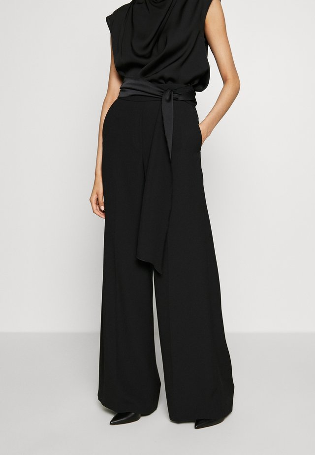 HEDENA - Trousers - black