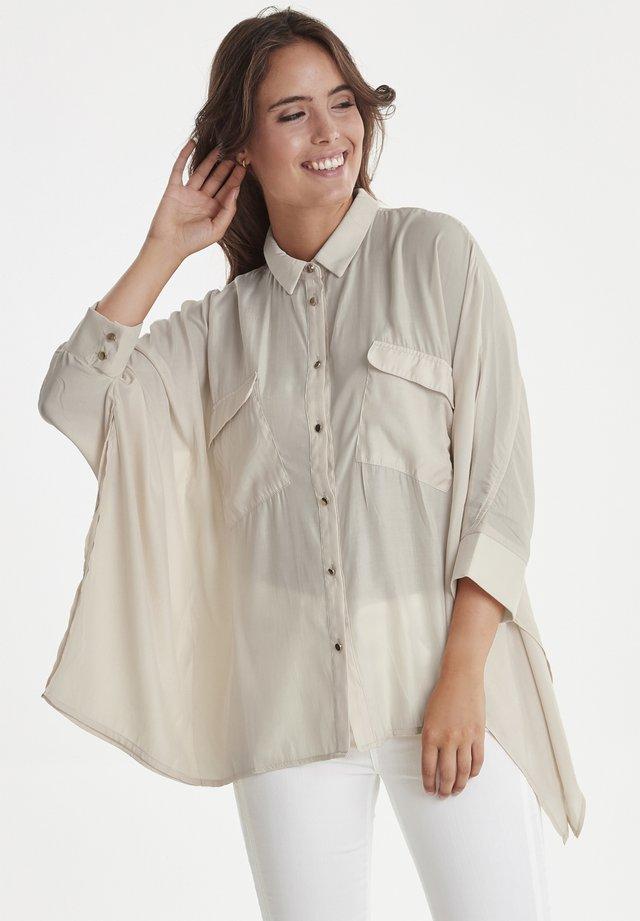 DXTRINA  - Button-down blouse - nude